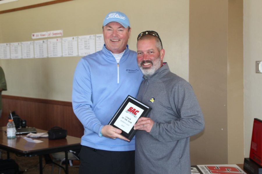 Head coach Kevin Millikan (right) holds his conference coach of the year award. Photo by Justin Tinder