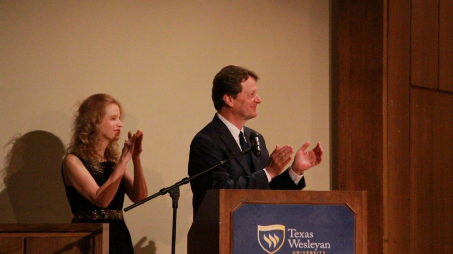 President Frederick Slabach and his wife Melany Neilson applauding the performers.