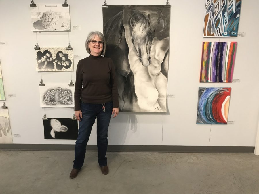 Director of the art gallery Dr. Kit Hall poses in Texas Wesleyans Bernice Coulter Templeton Art Studio. Photo by Carsen Cunningham
