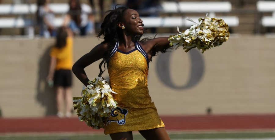 Captain Arlyssa Moaning performs during a football half-time show at Farrington Field. Photo by Little Joe