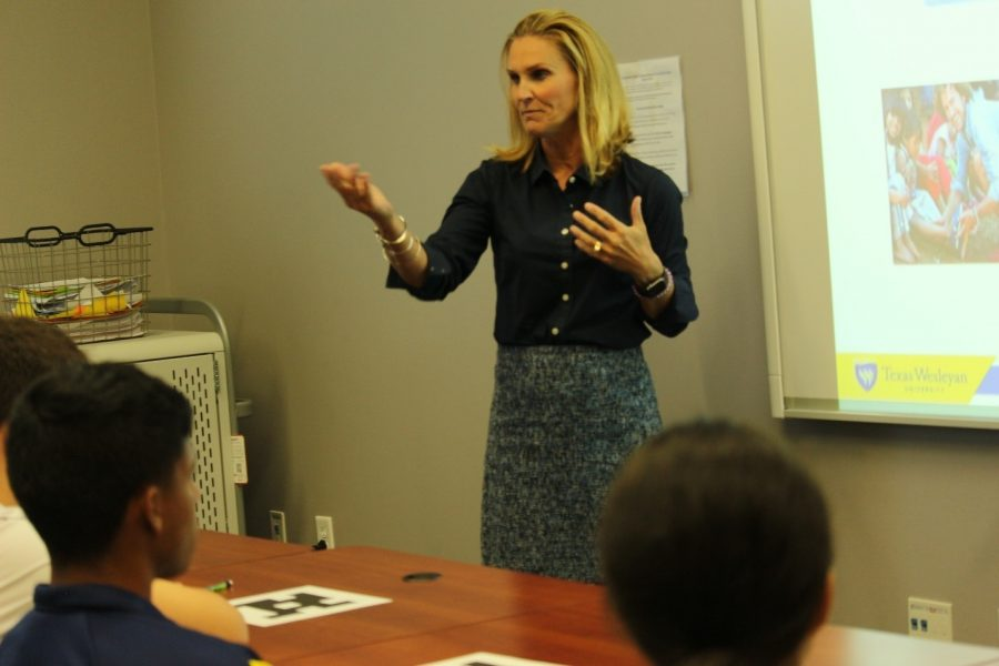 Dr. Meghan Wright demonstrates to new freshman that using 10 percent of our brain is false. Photo by Rachell Aguilar