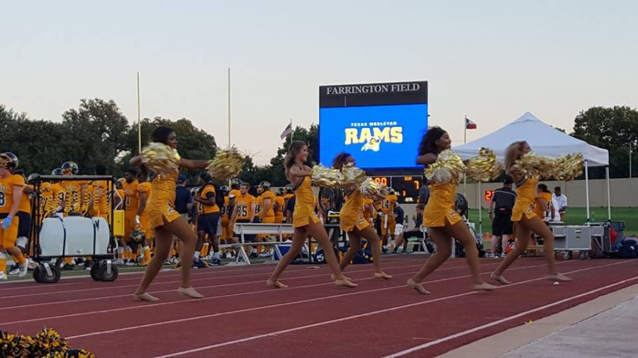 The+Gold+Line+dancers+celebrate+the+Rams+first+touchdown+of+the+season.%0APhoto+by+Amanda+Roach