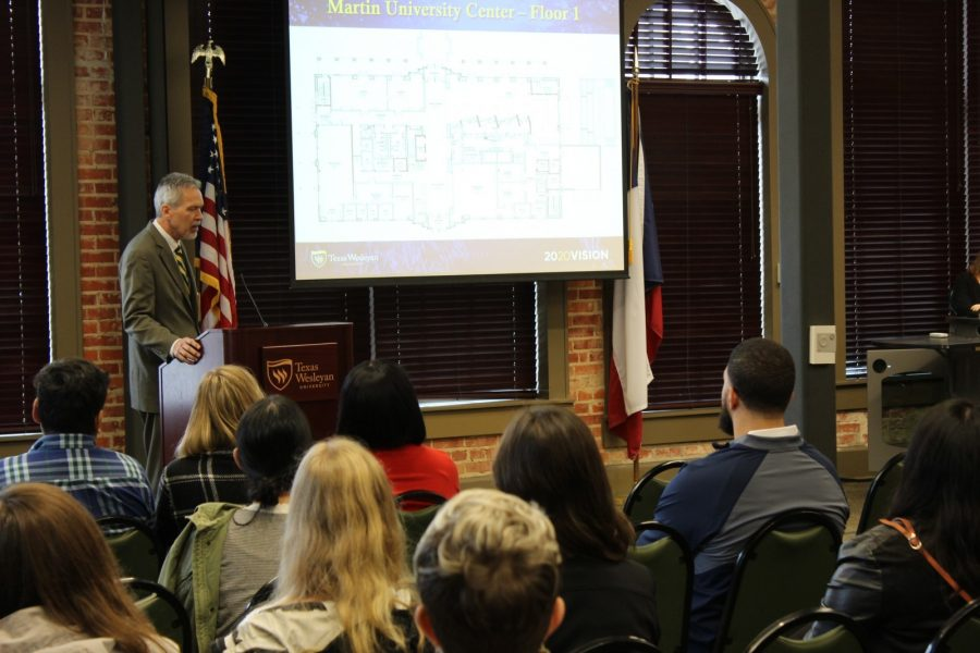 Jim Lewis talks about the Nick and Lou Martin University Center at the town hall meeting on Tuesday. Photo by Hannah Onder