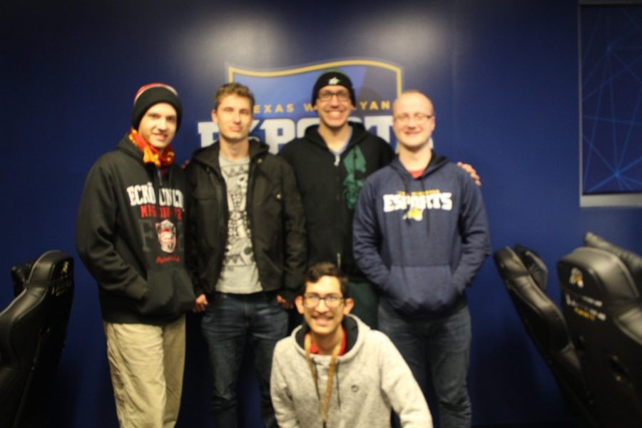 Hearthstone members (left to right) Chris Austin, Gordon Armbruster, Chris Campbell, and Jacob Chesney with (in front) Roberto Valdez pose for a group photo.  Photo by Rachell Aguilar