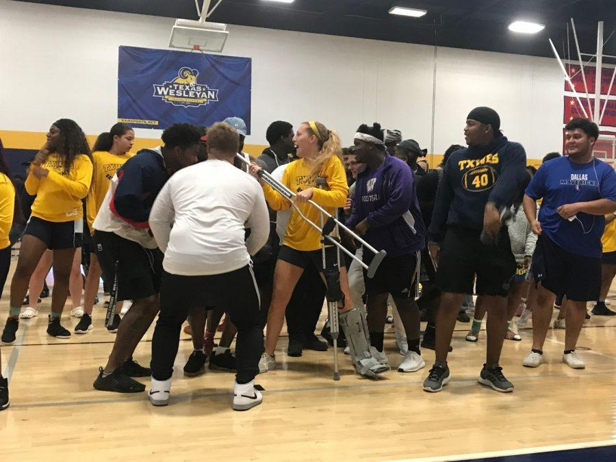 Students join in with the womens basketball team as part of the lip sync battle at Ram Rally.  Photo by Hannah Lathen