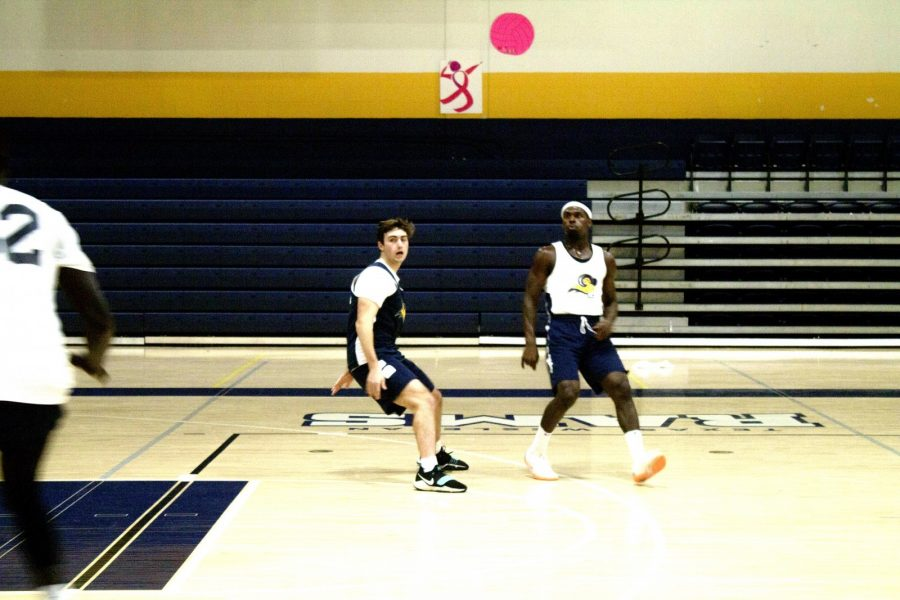 Senior guard Rob Thomas (right) practices for the fall 2018 basketball season. The Rams were ranked No. 11 in the NAIA in a Oct. 23 poll. Photo by Thomas Moore