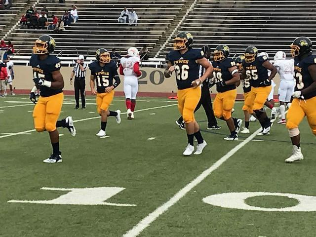 The Rams offense comes off the field after a play against Lyon College.  Photo by Ashton Willis