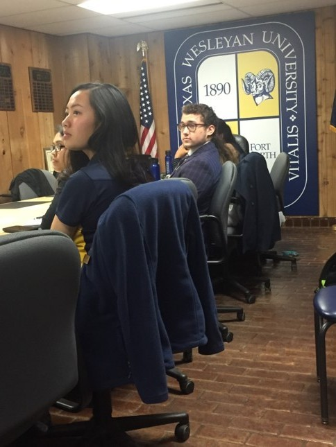 Phuong Le and other SGA members discuss amendments to the constitution at Fridays meeting. Photo by David Cason