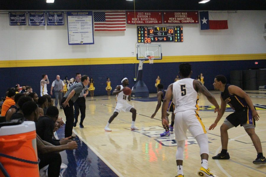 Rob Thomas (No. 12) takes the ball down the court during the first half of Thursdays win over LSU-Shreveport. Photo by Thomas Moore