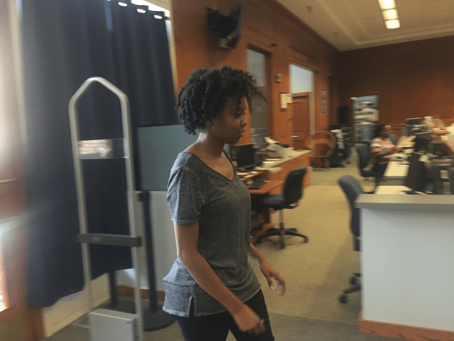 Senior criminal Justice major Kiana Veasley walks through the security gate to demonstrate how the new system works. Photo by Massaran Kromah