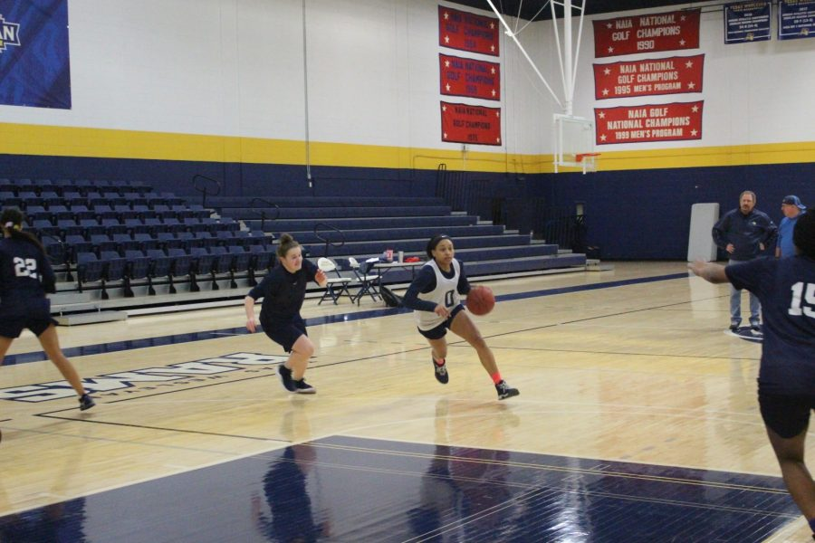 Adrianna Davis (right, with ball) drives past Karah Sicurella at a recent Lady Rams practice. Photo by Thomas T. Moore