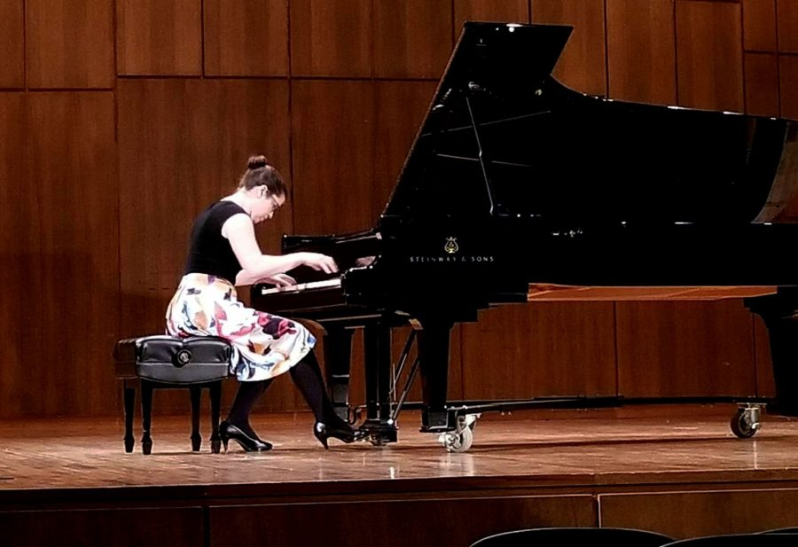 Jessica Koebbe plays the piano during her guest recital on Tuesday night. Photo by Elena Maldonado.