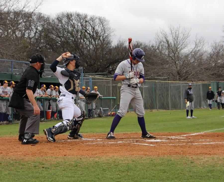 Junior catcher Tanner Amaral throws the ball down to third as the opposing runner from LSU- Alexandria tries to steal the base. Amaral helped fellow players with four assists and also had 13 putouts. Photo by Miranda Day.