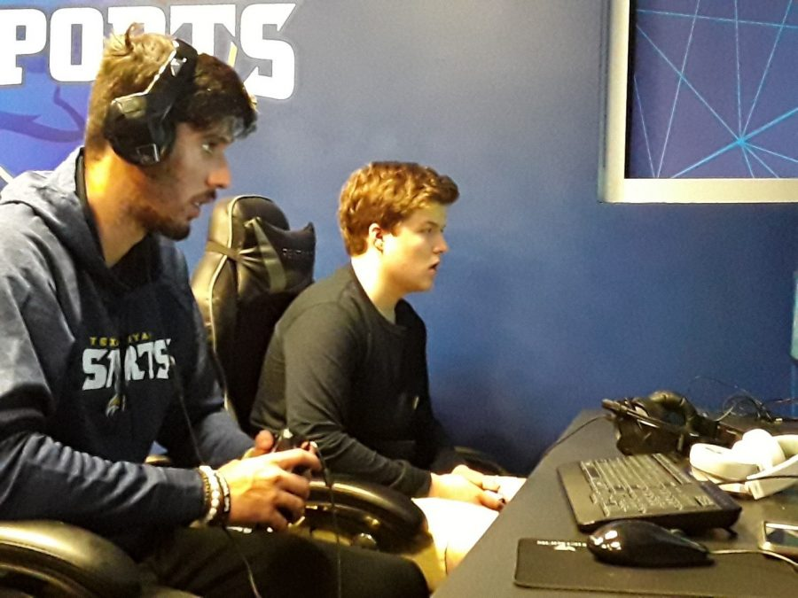 Freshmen general studies majors Teo Macedo and Nick Hains practice together for the FIFA team. Forty-nine people are currently in the Epsorts program. Photo by Elizabeth Lloyd
