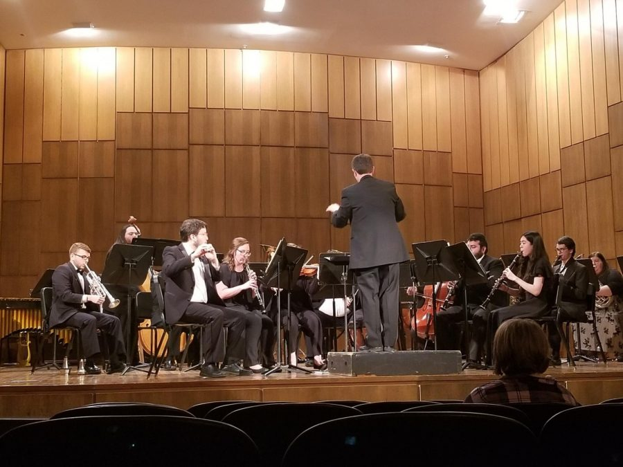 Dr. Paul Sikes directs the Wind Ensemble on Thursday at Martin Hall. Photo by Elena Maldonado