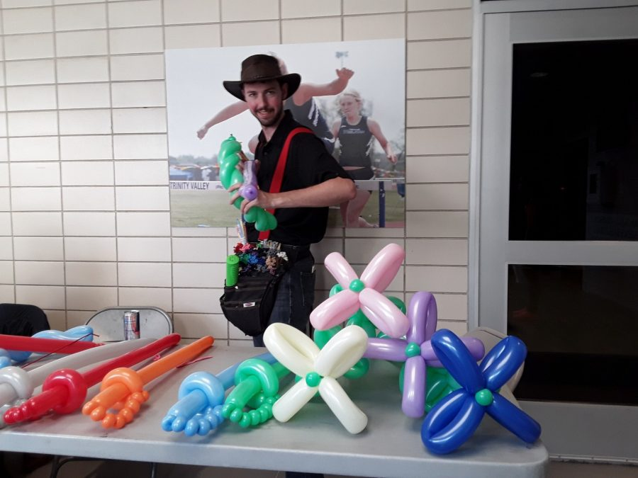 Matt Dawson poses with some of the balloon art he made at RamJam. Photo by Elizabeth Lloyd