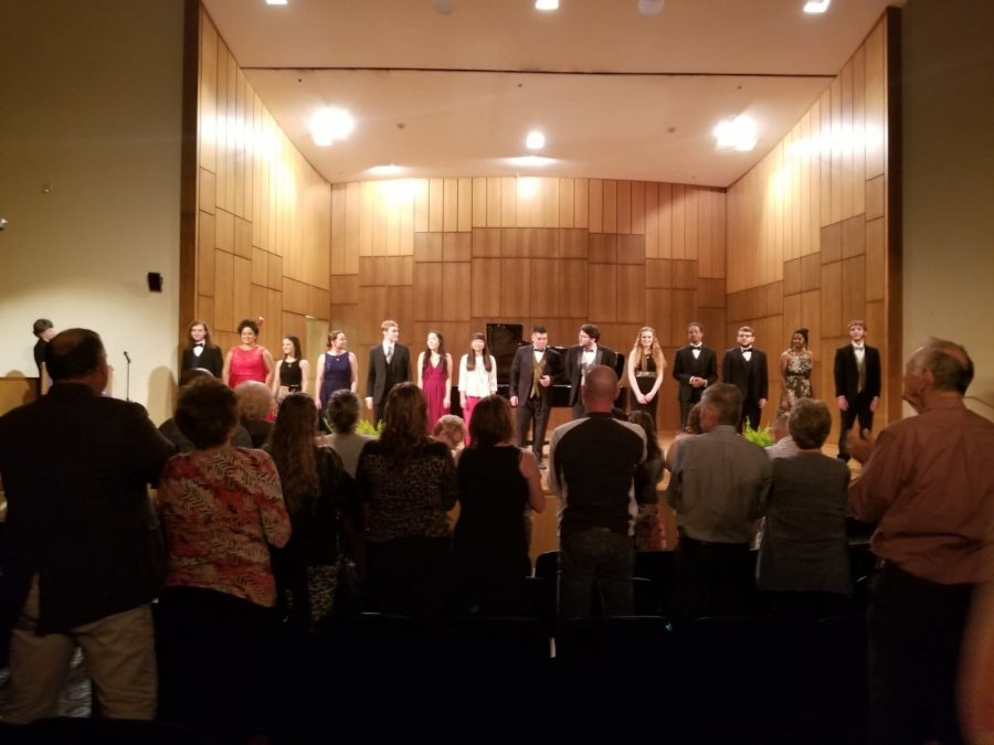 The performers stand in front of the crowd after Fridays concert. Photo by Elena Maldonado