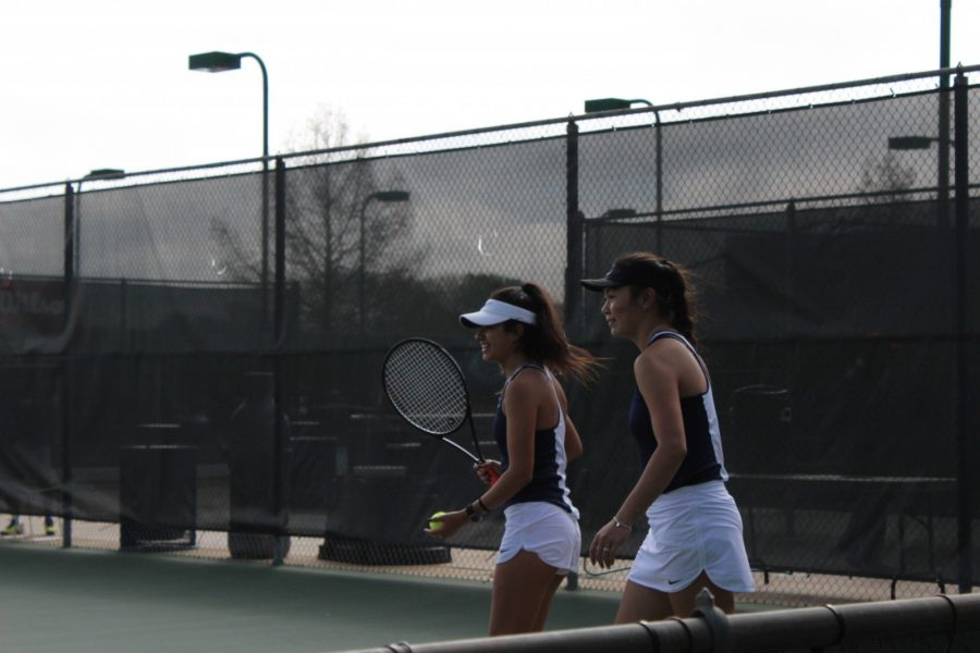 Caitlin Souvannavong (left) and Hannah Isabella Rey compete in doubles during Fridays match against Collin County Community College. Photo by LaTerra Wair