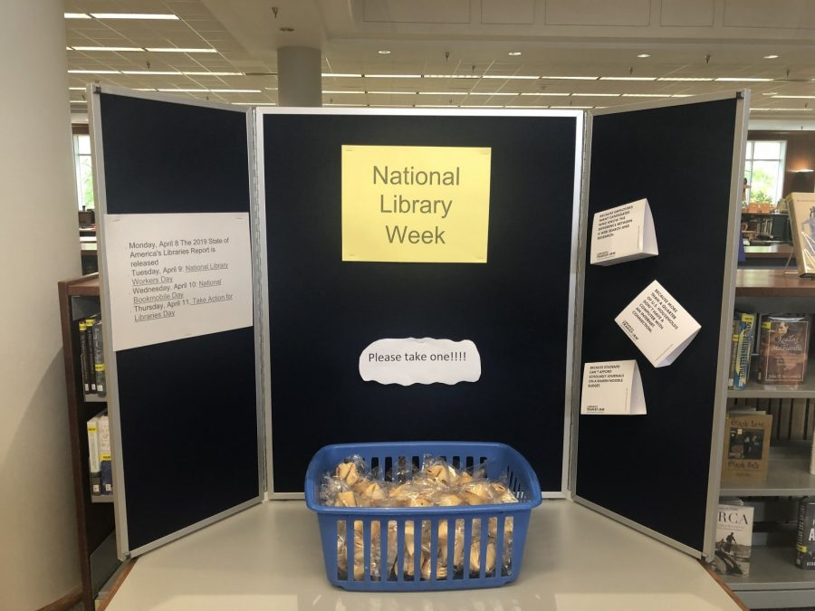 Students can pick up free fortune cookies this week as the West Library celebrates National Library Week; this display also features the weeks schedule of events.] Photo by Davonte Mitchell-Dixon