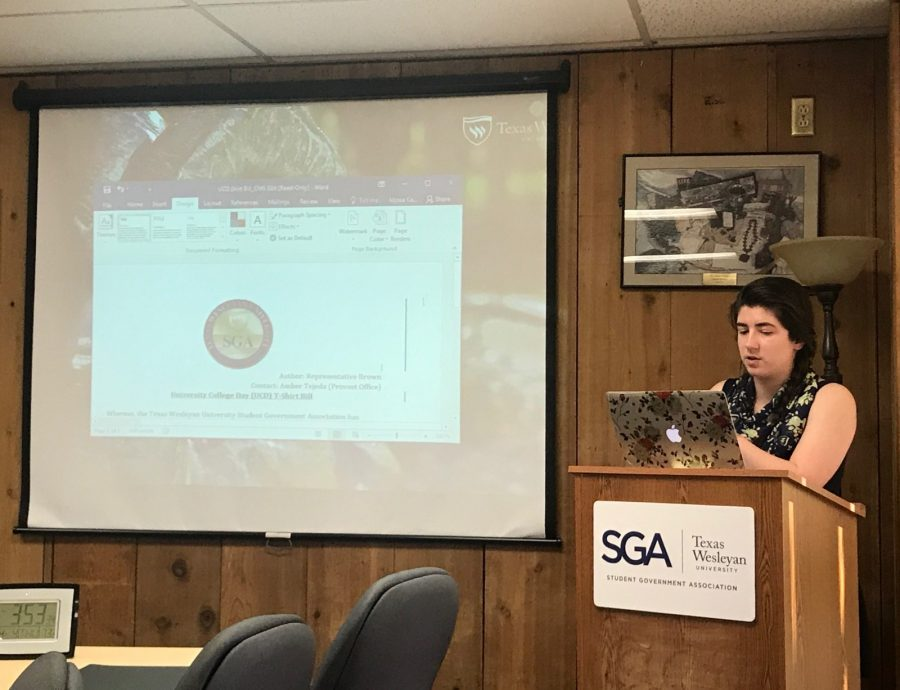 SGA Secretary Alison Baron presents the GSA Identity Painting Event bill at Thursdays meeting. Photo by Hannah Lathen