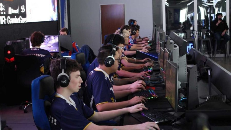 Parker Anderson (nearest the camera) and the Esports Overwatch team compete during a tournament n Dallas. This was the first year that Wesleyan has had a team. Photo by Eugene Friar