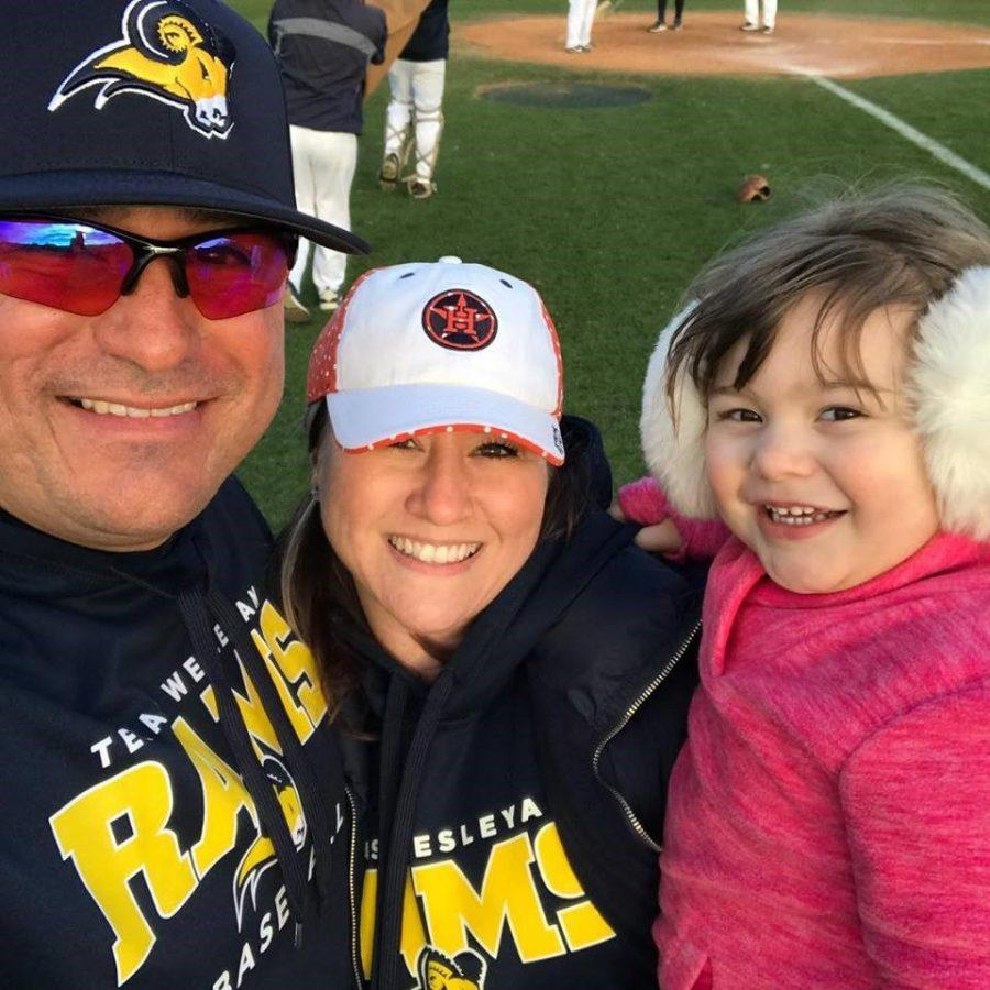 Robert Garza, his wife and daughter pose for a selfie on the field.  Photo courtesy of Robert Garza
