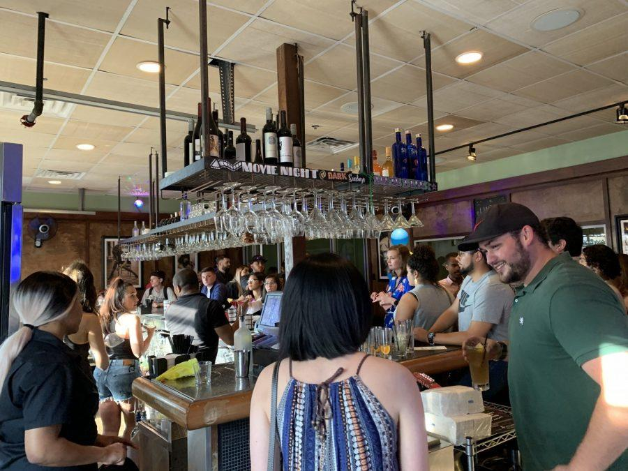 Class of 2019 members get drinks at the bar with their free drink ticket. Photo by Jacinda Chan