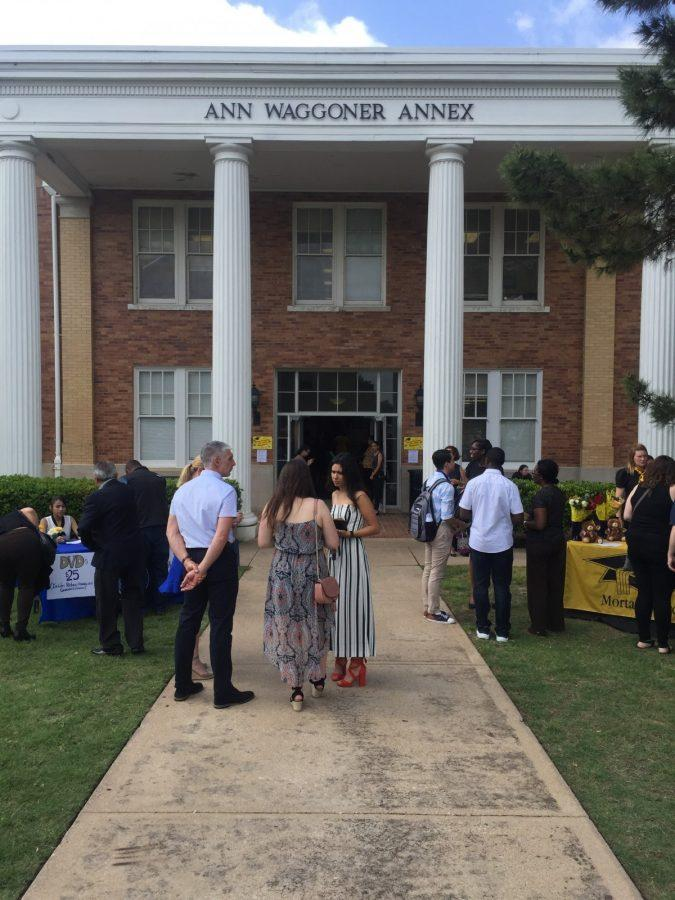 Family members gather outside Martin Hall before Fridays Robing Convocation. Photo by David Cason