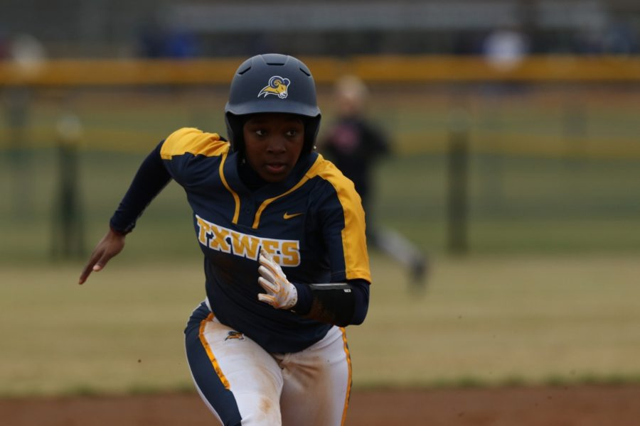Freshman Kimani  Ferguson runs to the plate at the Cowtown Classic in February at Gateway Park. Photo courtesy of Little Joe