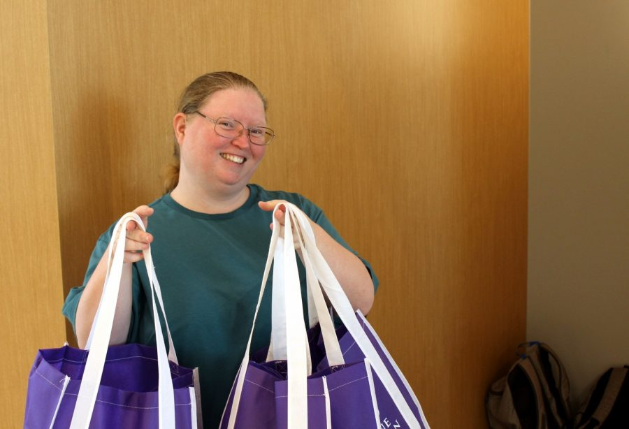 Senior sociology major Stacie Hill poses with her three tote bags of information. She gathered two of the bags for friends that werent on campus on Thursday. Photo by Hannah Onder