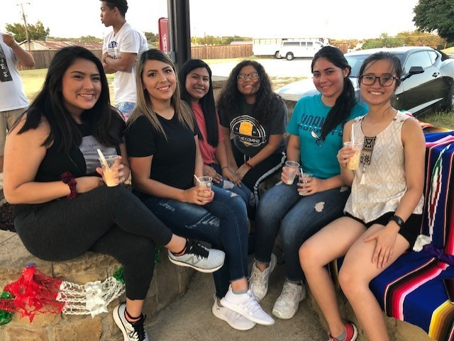 Members of BSA and SGA and other students  and students enjoy a cup of elote. Photo by Arely Chavez