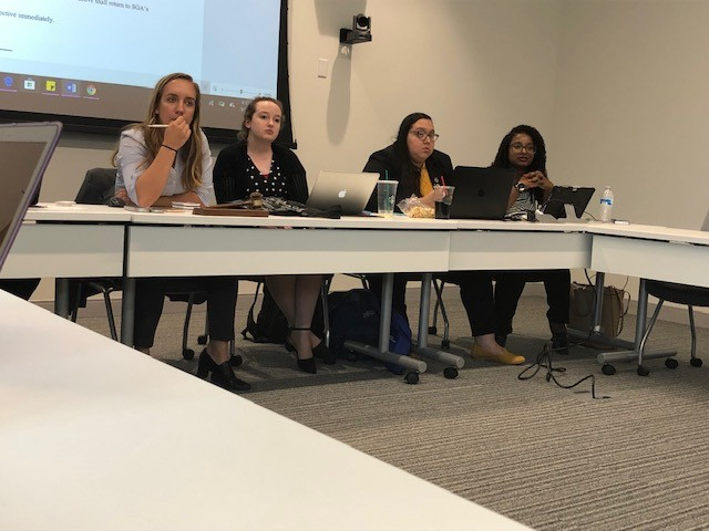 SGA executive officers (left to right) Alyssa Hutchinson, Lexi Barlow, Karen Duarte-Escobar, and Kierra Glover listen to the discussion of one of the bills presented at Tuesdays meeting. Photo by Arely Chavez