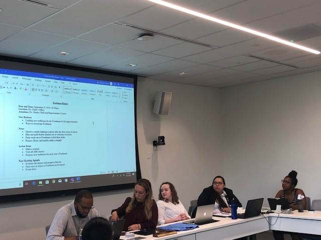 SGA executive officers (left to right) Carlos Mathurin, Alyssa Hutchinson, Lexi Barlow, Karen Duarte-Escobar, and Kierra Glover listen as Meghan Lewis presents her report. Photo by Arely Chavez