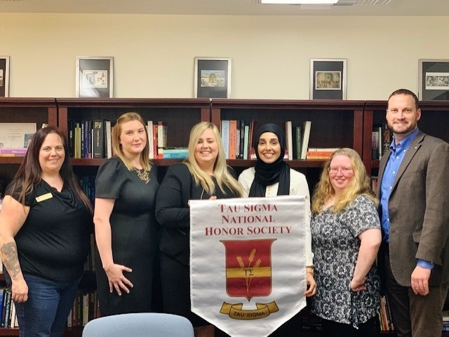 """Beth Jackson, Kirsten Trudo, Jennifer Harrison, Nadine Yasin, Stacie Hill, and Dr. Chad Pevateaux (left to right) pose for a photo commemorating them as the Tau Sigma Honor Society officers and advisors for 2019-20. """"Like an old restaurant might hang a sign saying, Under New Management, were under new leadership. As director of liberal studies, I work primarily with transfer students and was asked to take over as faculty sponsor for Tau Sigma, the national honor society to recognize outstanding transfer students. And now we have some great new members, four of whom have volunteered to take leadership roles as new officers. Their energy is contagious!Beth Jackson, academic coordinator for liberal studies, also is helping out immensely,"""" Pevateaux wrote.  Photo contributed by Stacie Hill"""