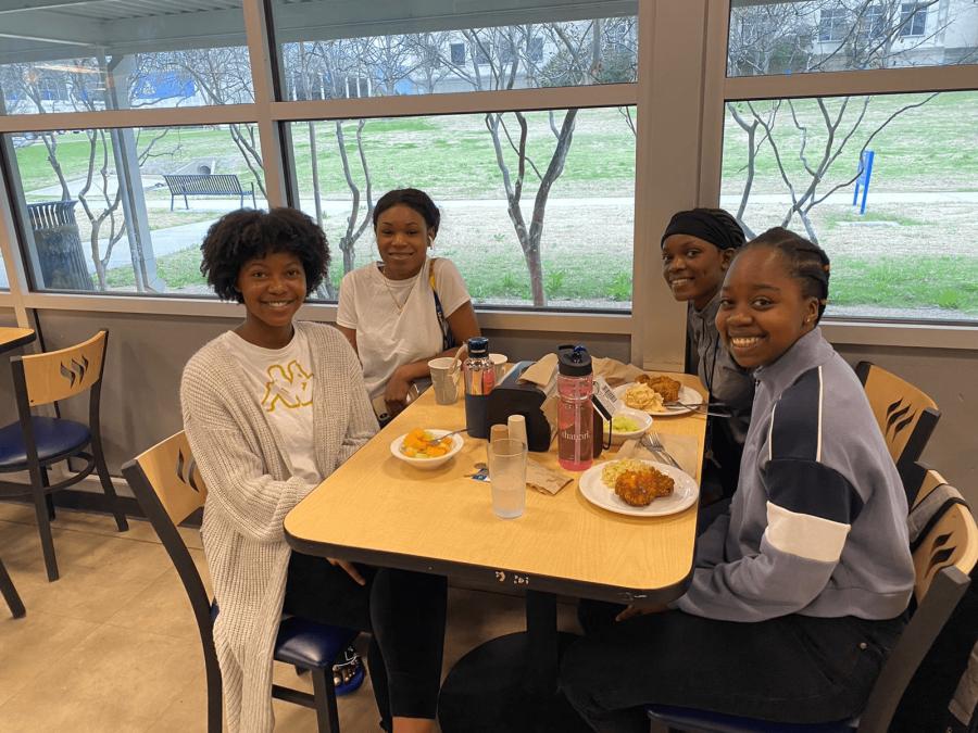 International students Bev Nkomo, Tatyana Archer, Lorrain Nyamwela and Lukundo Chikuye eat together at Doras. All four have plans for spring break. Photo by Sharon I. Ibe Mthembu.