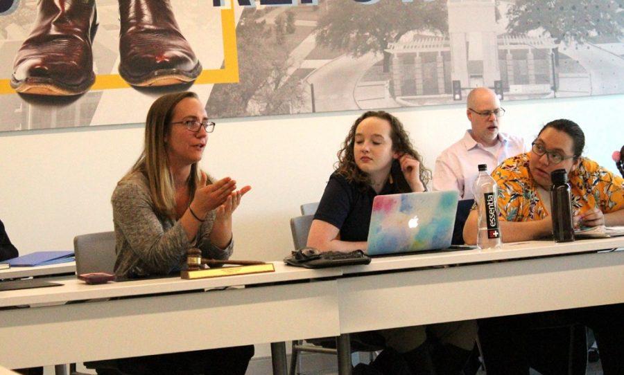 SGA President Alyssa Hutchinson talks to Lexi Barlow and Karen Duarte-Escobar (left to right) during a SGA meeting. Photo by Hannah Onder