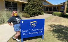 Cindy Flores poses outside James C. Armstrong & O.C. Armstrong Hall. Flores moved into O.C. Hall after a four-hour drive up from Houston with her mom, Maria, and her two brothers, Isabel and Giovanny. Photo by Hannah Onder