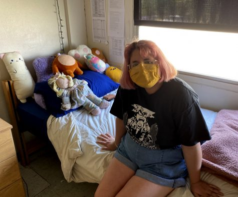 Cindy Flores poses in her dorm room in James C. Armstrong & O.C. Armstrong Hall. Flores's mom, Maria, and her older brother, Isabel, took turns assisting her with moving in for the fall 2020 semester. Photo by Hannah Onder