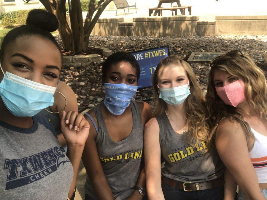 Iyanna Brown (left) poses with (named in order left to right), Katelyn Gordon, Jacy Hubartt and Justyna Kersten, fellow Gold Line and cheer team members around campus during opening week. Photo courtesy of Iyana Brown.