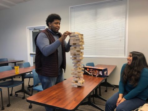 Nerd Central Officers Gloria Cabral and Azeez Akanda, compete in a thrilling game of Jenga on March 6, 2020. Image by Elizabeth A. M. Howard.