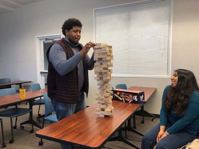 Nerd+Central+Officers+Gloria+Cabral+and+Azeez+Akanda%2C+compete+in+a+thrilling+game+of+Jenga+on+March+6%2C+2020.+Image+by+Elizabeth+A.+M.+Howard.