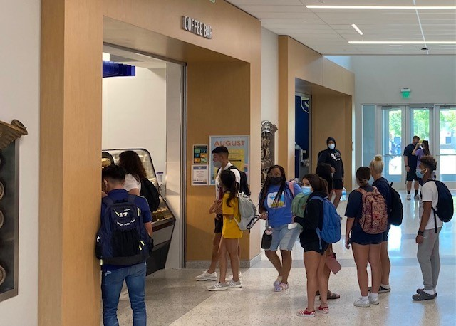 Students wait in long lines in the mornings at the coffee shop on campus