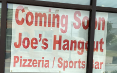 Joes Hangout displays a sign in the store-front window stating they are coming soon.