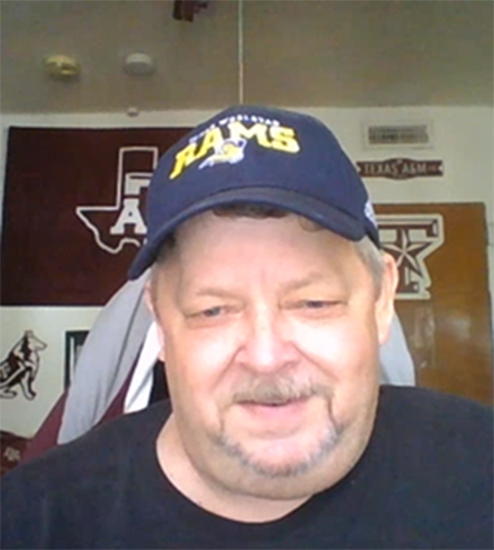 """Greg Burnette is an Aggies fan, having received his associates degree in electronics from the A&M extension school in 1983. """"I try to alternate, one day Rams and the next an Aggies, I support both my schools,"""" he said."""